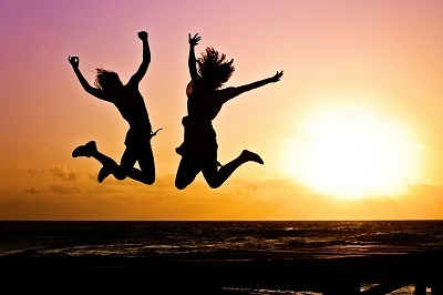 Two people jumping happily