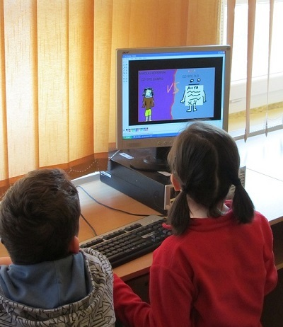 Children using a computer at a school