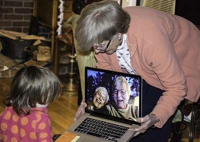 Small child video calling with grandma