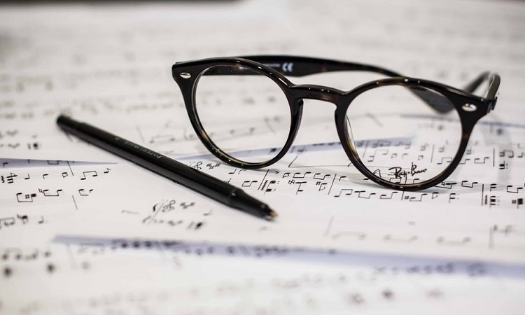 Glasses resting on sheet music
