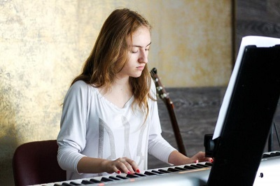 Person practicing playing piano