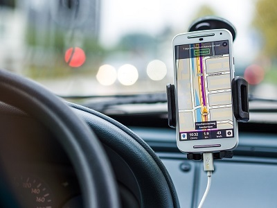 Road app and smartphone mounted on dashboard