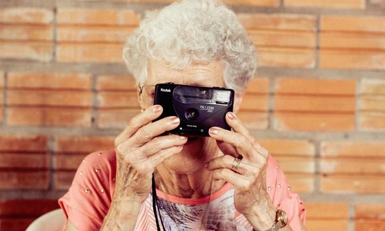 Older woman using a digital camera