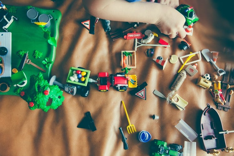 Child with playset laid out