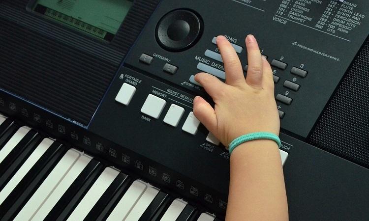 Child playing a keyboard