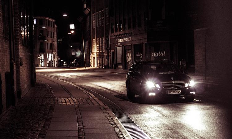 Car driving down a dark road