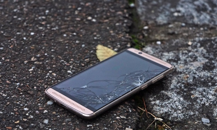Cracked smartphone on the street