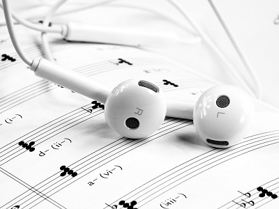 Earbuds on sheet music