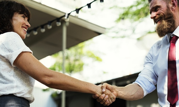 Host shaking hands with guest