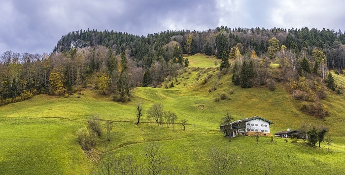 Photo of a home a the foothills of a mountain